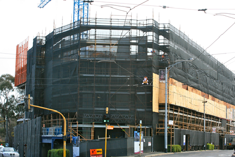 front of caulfield village with scaffolding in place