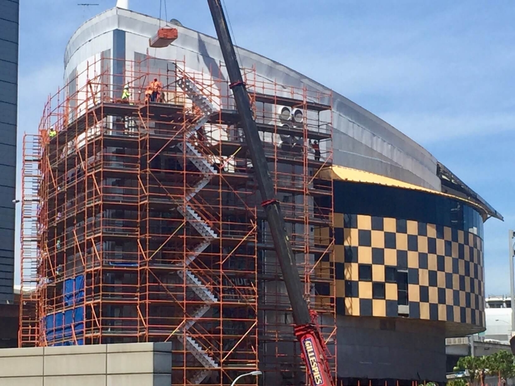 men working on imax building scaffold