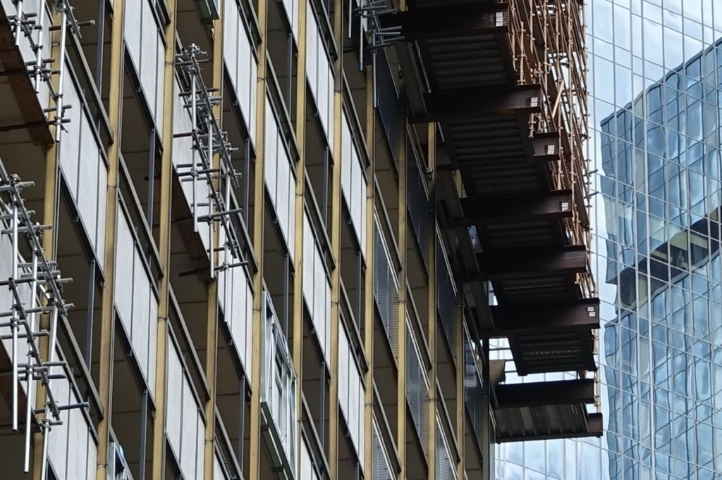 view up to large scaffold beams and rigging at suncorp building