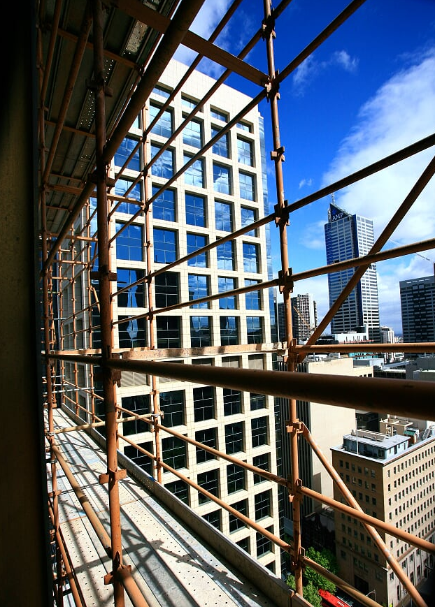 view of city through scaffold at suncorp building