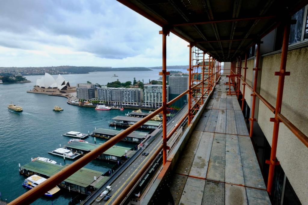 scaffold walkway on large building overlooking sydney