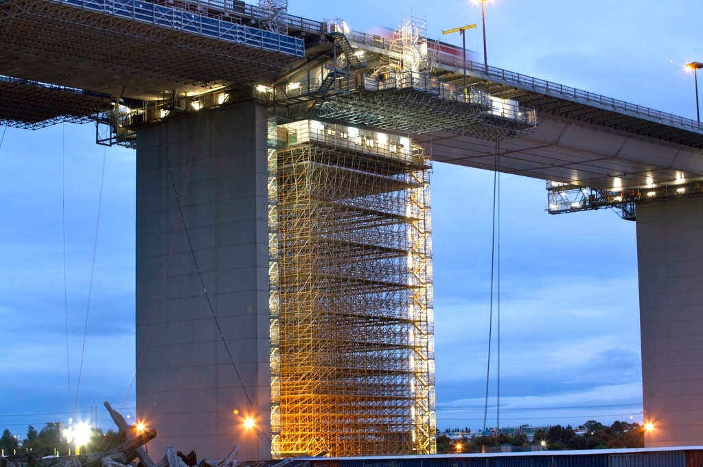night image of scaffold and offices high up on westgate bridge